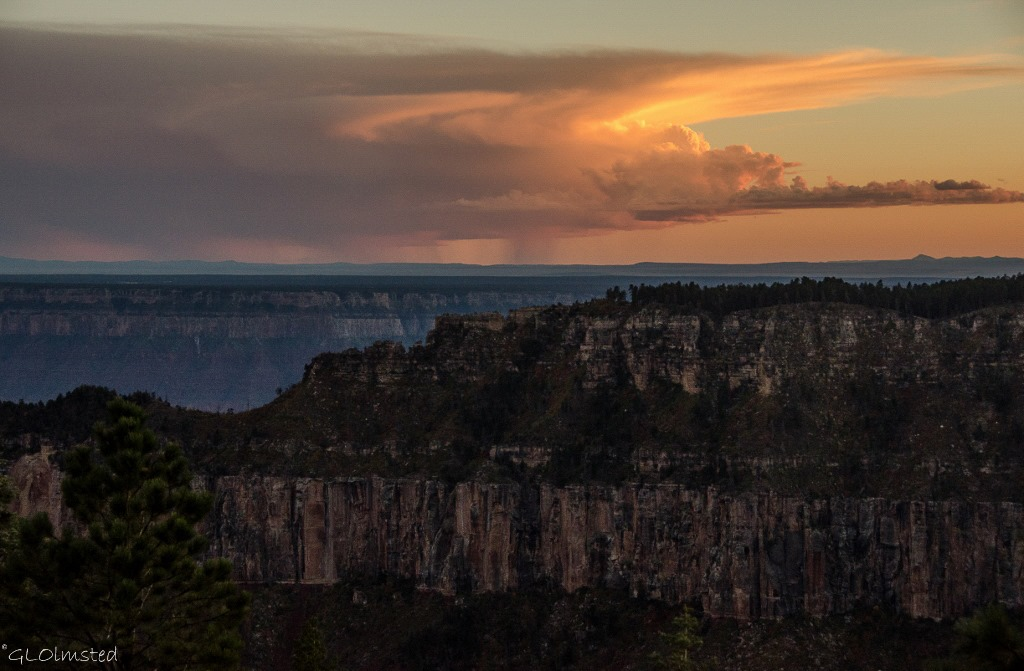 Sunset and rain over South Rim from North Rim Grand Canyon National Park Arizona