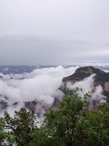 Clouds in canyon & Widforss Plateau from Bright Angel Point North Rim Grand Canyon National Park Arizona