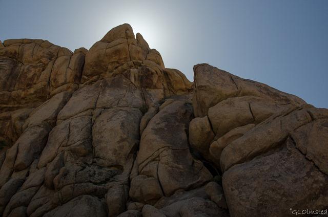 Sun behind boulders Hidden Valley Joshua Tree National Park California