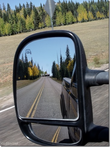 Fall colors & entrance station in side mirror SR67 Kaibab National Forest Arizona