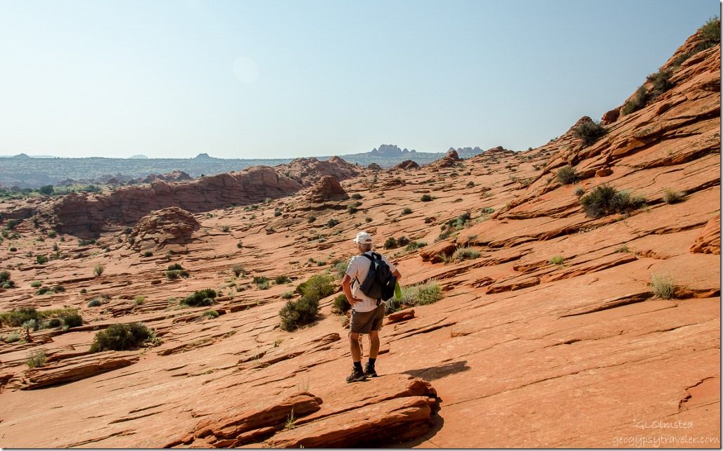 Bill & Teepees in disance Coyote Buttes trail Paria Canyon-Vermilion Cliffs Wilderness Utah
