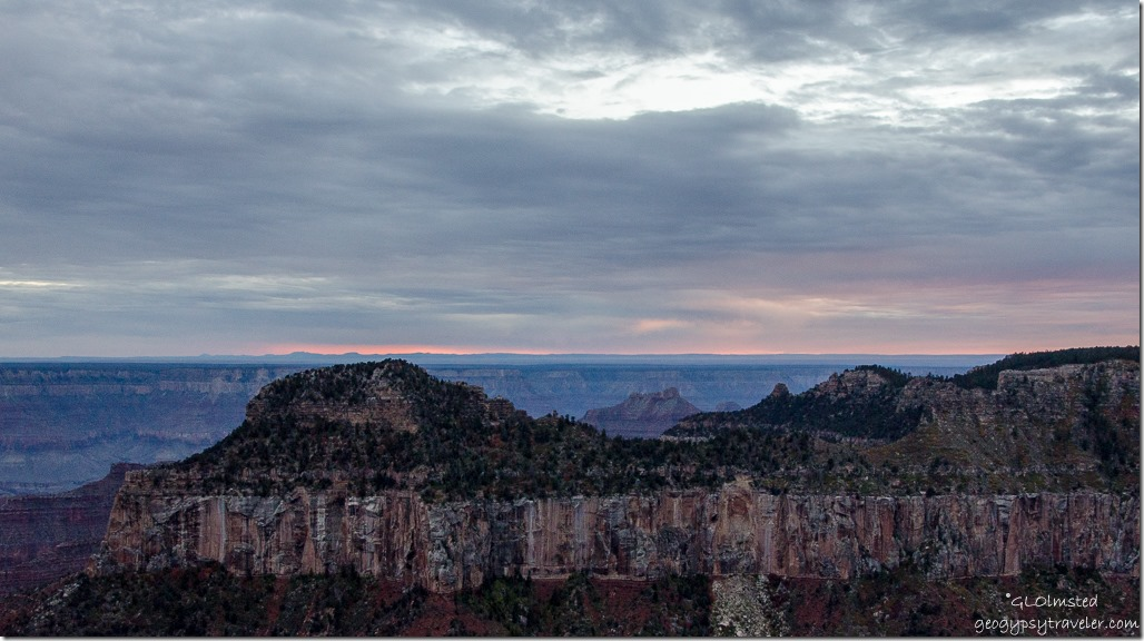 Low clouds at sunset over Oza Butte from Lodge North Rim Grand Canyon National Park Arizona
