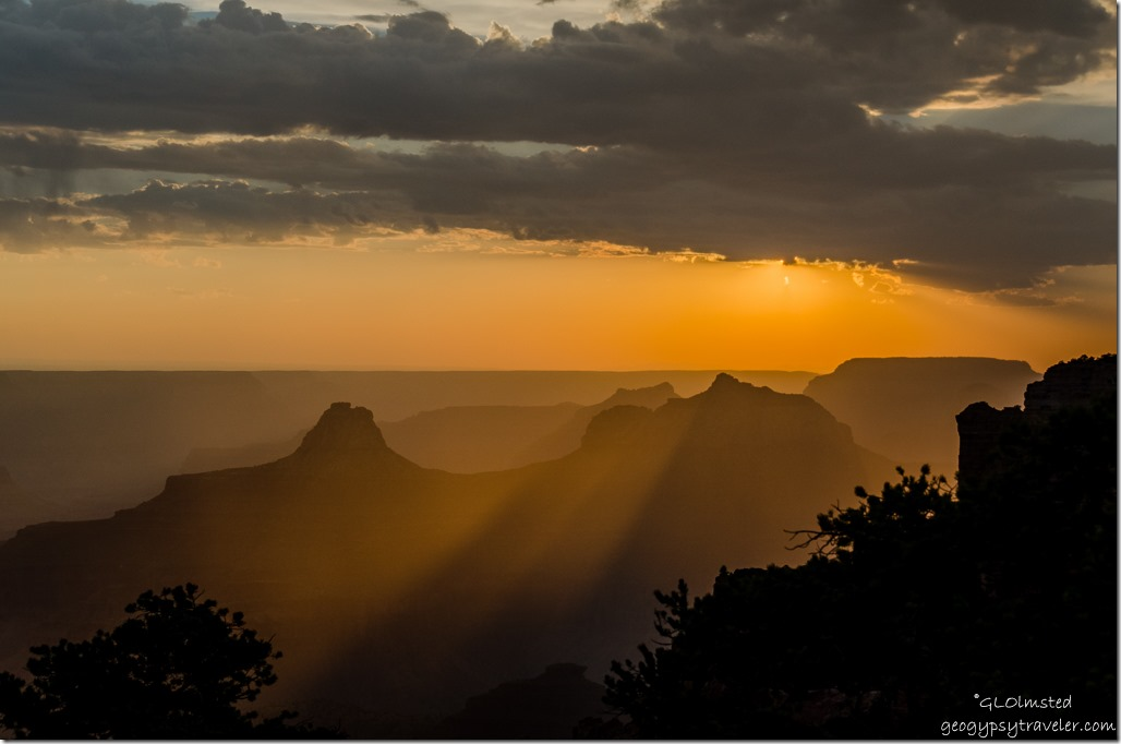 Crepscular rays sunset Cape Royal North Rim Grand Canyon National Park Arizona