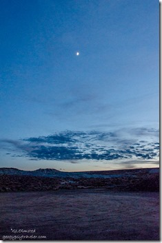 Moon at sunset Lake Powell Lone Rock campground Glen Canyon National Recreation Area Utah