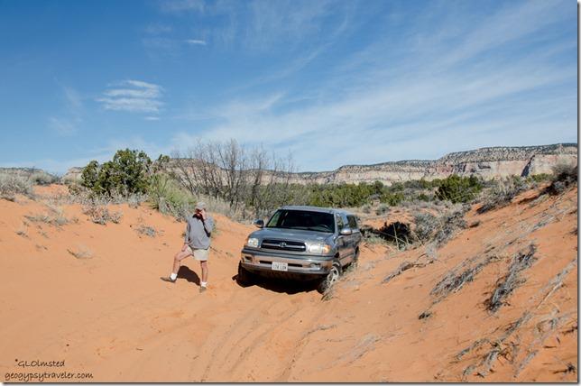 Bill & dead truck sand dunes ATV road to Peekaboo Canyon Utah