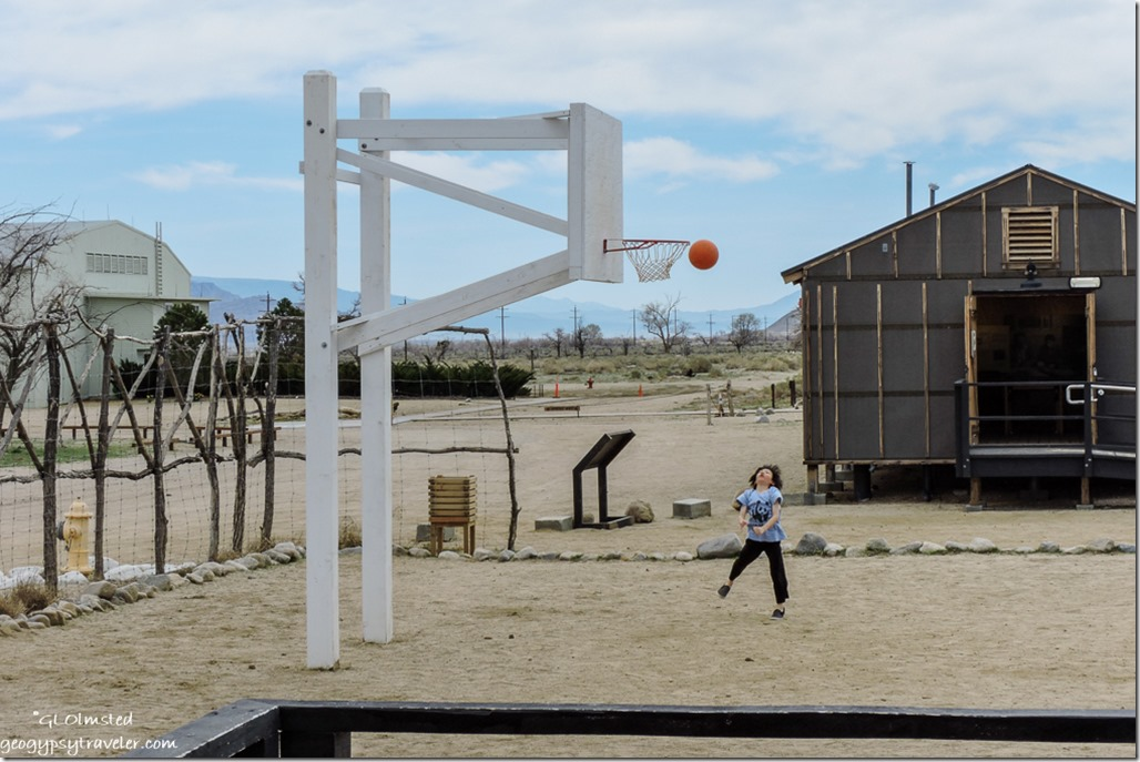 Asian boy playing basketball Manzanar National Historic Site Independence California