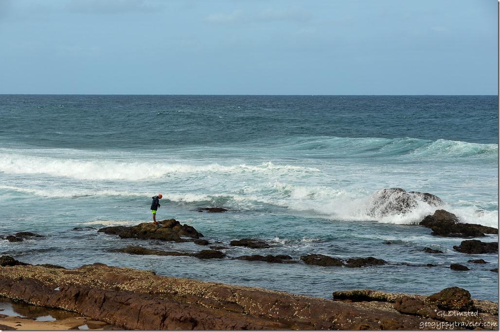 Fisherman on rock in Indian Ocean Scottburgh Caravan Park Scottburgh South Africa