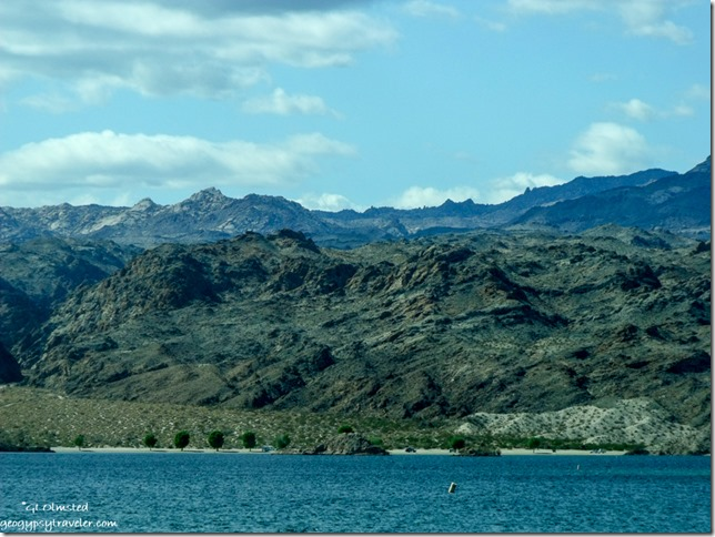View West of mountains & river along Colorado River frontage road North of Bullhead City Arizona