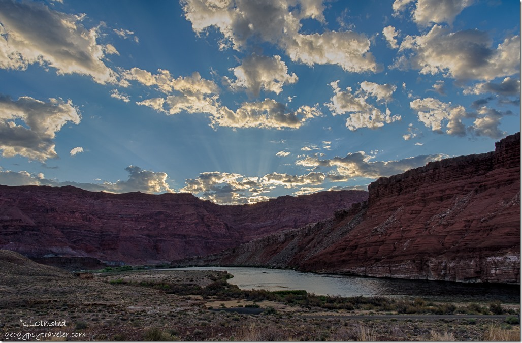 sunrise rays Echo Cliffs Colorado River from camp Lee's Ferry Glen Canyon National Recreation Area Arizona