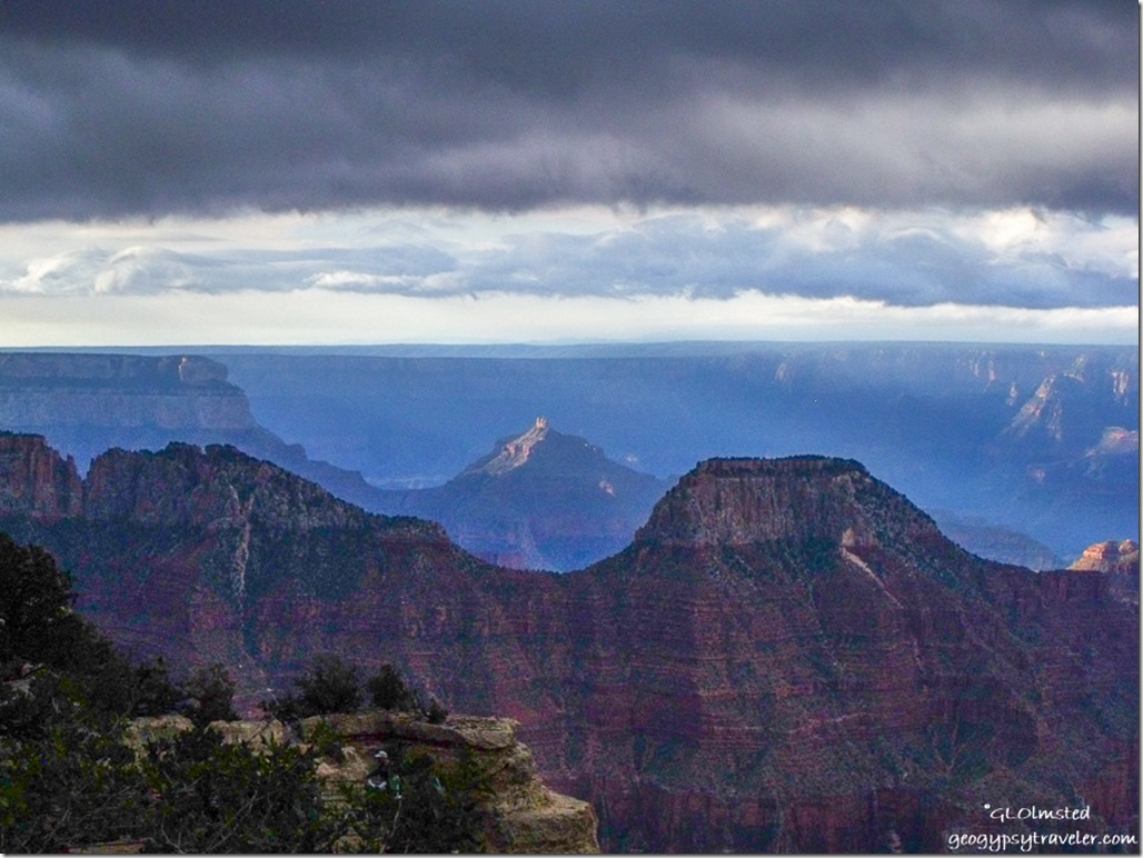 dark sky over morning sunlit temples from Lodge North Rim Grand Canyon National Park Arizona